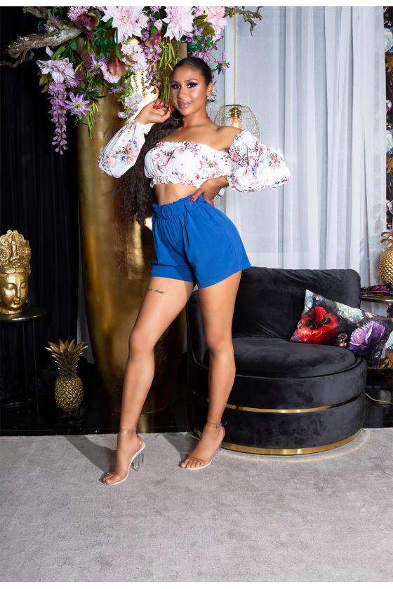 Madingi platėjantys džinsai su įplėšimu_198917