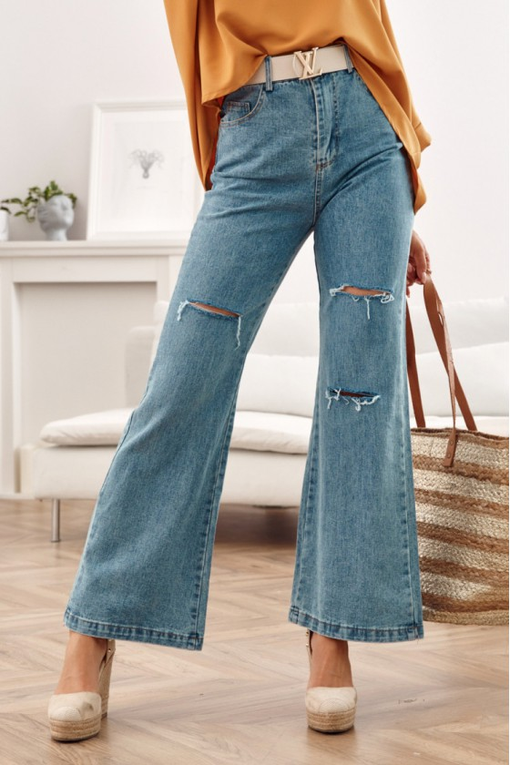 Plėšyti platėjančio modelio džinsai